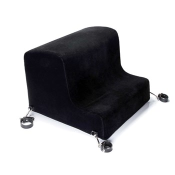 Liberator Obeir Spanking Bench with cuffs laid out