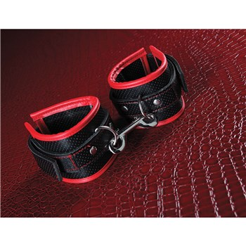 A&E's Scarlet Bound To Surrender Cuffs with cuffs on red background