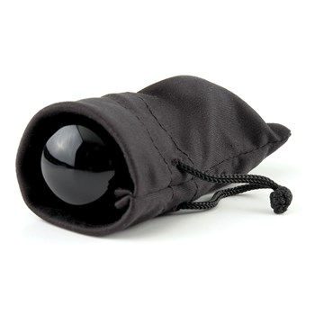 Black Glass Ben Wa Balls sitting inside storage bag
