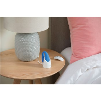 We-Vibe Match Couples Massager displaying on table