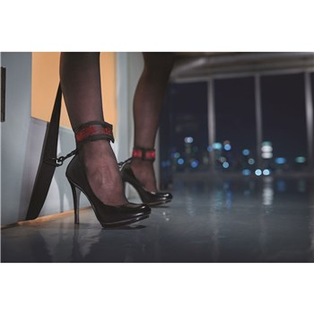 Scandal Over The Door Cross close up of leg cuffs