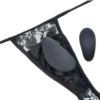 Screaming O Ergonomic Panty Set panties with vibe and remote laying on top