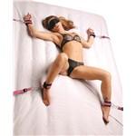Frisky Pink Bedroom Restraint Kit - Model on bed